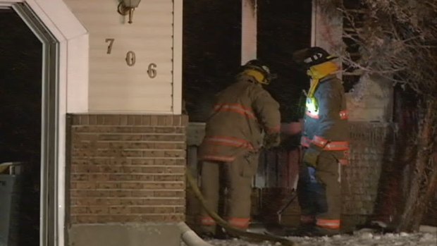 Firefighters look for hot spots after a fire early