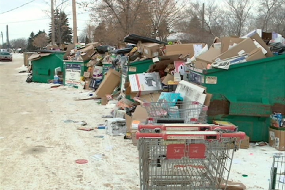Despite being emptied every day, cardboard recycling bins in Saskatoon are overflowing.