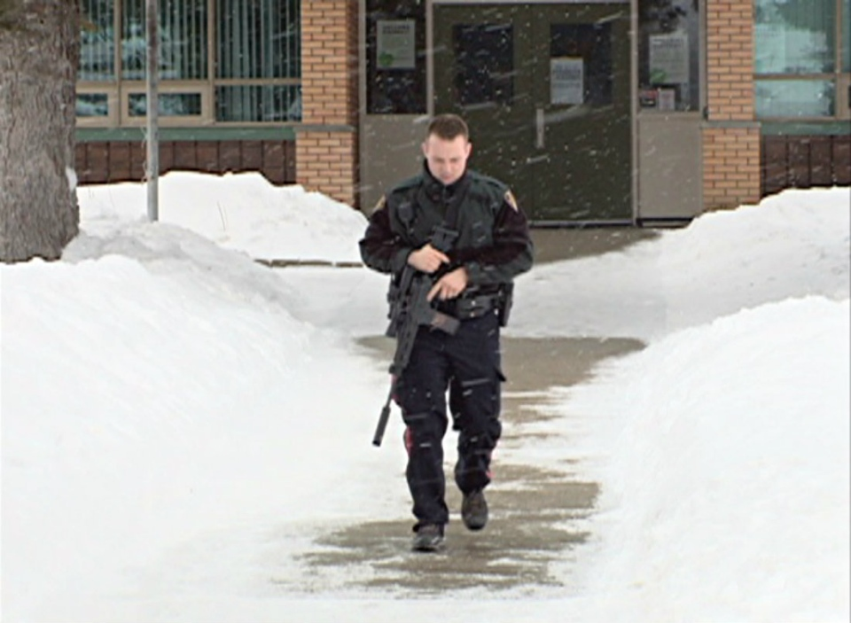 Police were called to John Lake School after two young students allegedly saw a man with a gun outside of the school.