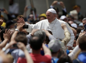 Pope Francis greets the faithful in St. Peter Square at the Vatican, after celebrating a Pentecost mass, Sunday, May 19, 2013.(AP Photo/Andrew Medichini)