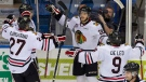 Oliver Bjorkstrand (left), Tyler Wotherspoon, Taylor Leier and Chase De Leo of the Portland Winterhawks celebrate a goal during the first period Monday. (Liam Richards/Canadian Press)