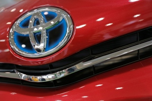 The emblem of a Toyota car shines at Toyota Motor Corp.'s showroom Toyota Mega Web in Tokyo Friday, Aug. 2, 2013. (AP / Itsuo Inouye)