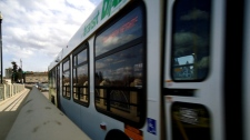 A Saskatoon Transit bus passes a stop in Saskatoon
