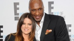 """This April 30, 2012 file photo shows TV personality Khloe Kardashian Odom and professional basketball player Lamar Odom from the show """"Keeping Up With The Kardashians."""" (AP / Evan Agostini, File)"""