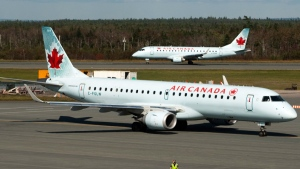 Air Canada planes are shown in this undated image. (Andrew Vaughan / THE CANADIAN PRESS)