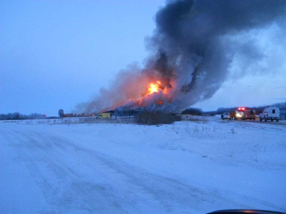 The barn was full engulfed in flames shortly after emergency crews arrived. (RCMP)