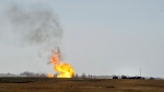 Remaining gas is burned off after an explosion and fire at a gas pumping station owned by TransGas near Prud'homme, Sask., Saturday, October 11, 2014. THE CANADIAN PRESS/Liam Richards