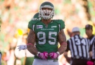 Saskatchewan Roughriders defensive end Ricky Foley celebrates a sack against the Edmonton Eskimos during the first quarter of CFL football action in Regina, Sask., Sunday, October 19, 2014. THE CANADIAN PRESS/Liam Richards