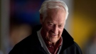 Hockey great Gordie Howe watches the Vancouver Canucks and San Jose Sharks play during an NHL hockey game in Vancouver on Thursday, Nov.14, 2013. (Darryl Dyck / THE CANADIAN PRESS)