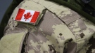 A Canadian flag sits on a member of the Canadian Armed Forces that leaving from CFB Trenton, in Trenton, Ont., on Thursday, Oct. 16, 2014. (The Canadian Press/Lars Hagberg)