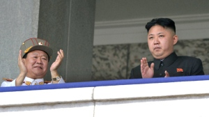 North Korean leader Kim Jong Un, right, and the Korean People's Army Vice Marshal and Vice Chairman of the Central Military Commission Choe Ryong Hae clap after Kim made a speech during a mass military parade in Kim Il Sung Square in Pyongyang, North Korea, Sunday, April 15, 2012. (AP / Kyodo News)