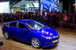 The 2016 Chevrolet Volt hybrid drives on stage at a presentation during the North American International Auto Show, in Detroit, Monday, Jan. 12, 2015. (AP / Tony Ding)