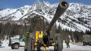 Under the direction of Parks Canada&#39;s avalanche forecasters, Canadian soldiers bombard known trigger zones high up on the avalanche paths of Rogers Pass, B.C. as part of the largest mobile avalanche control program in the world.<br><br>Members of the 1st Regiment of the Royal Canadian Horse Artillery (1RCHA) put a 105mm Howitzer in position at Rogers Pass, B.C. on Wednesday, March 4, 2015. (Jeff Bassett / THE CANADIAN PRESS)