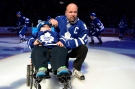 Former Toronto Maple Leafs captain Wendel Clark and 11-year-old Garrett Gamble Jr. prepare for a ceremonial puck drop prior to NHL action between the Toronto Maple Leafs and the Ottawa Senators in Toronto on Saturday, March 28, 2015. (Frank Gunn / THE CANADIAN PRESS)