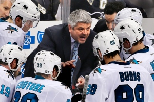 In this March 29, 2015, file photo, San Jose Sharks head coach Todd McLellan, center, talks to his team during a timeout in the third period of an NHL hockey game against the Pittsburgh Penguins in Pittsburgh. (AP Photo/Gene J. Puskar)