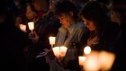 Residents of a rural Saskatchewan community huddled together in a town square to remember a mother and three children in Tisdale, Sask., on Wednesday, April 29, 2015. THE CANADIAN PRESS/Matthew Smith