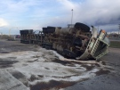 A semi rolled over on Highway 1 at Ninth Avenue in Moose Jaw, Sask. Saturday morning (Photo: Twitter/@MJPolice)