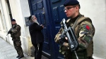 French soldiers secure the access to a Jewish school, in Paris, on Tuesday, Jan. 13, 2015. (AP Photo/Thibault Camus)