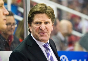 In this Nov. 24, 2014, file photo, Mike Babcock reacts on the bench during the first period of an NHL hockey game against the Ottawa Senators in Detroit. (Tony Ding/AP Photo)