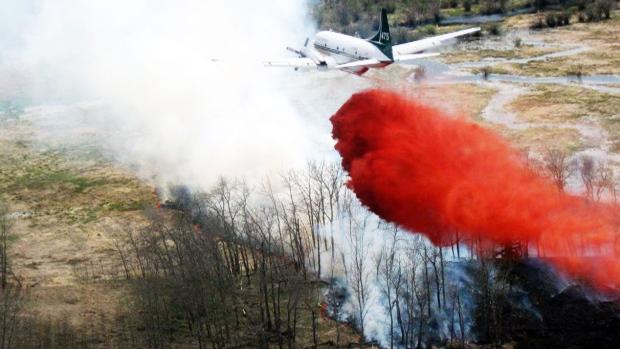 A water bomber striking a wildfire, Thursday, July 2, 2015. (Saskatchewan Ministry of Environment)