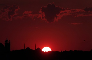 The sun sets behind Istanbul's skyline, Tuesday, July 14, 2015. (Lefteris Pitarakis / AP Photo)