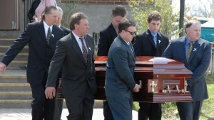 Pallbearers carry the casket of a Medicine Hat, Alta. man outside a church in Sudbury, Ont., Tuesday, May 2, 2006 following the funeral of the man, his wife and their eight-year-old son. (Gino Donato / THE CANADIAN PRESS)