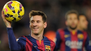 This is a Sunday, Dec. 7, 2014 file photo of FC Barcelona's Lionel Messi holding the ball after scoring a hat-trick in the Spanish La Liga soccer match between FC Barcelona and Espanyol at the Camp Nou stadium in Barcelona, Spain. (AP / Manu Fernandez)