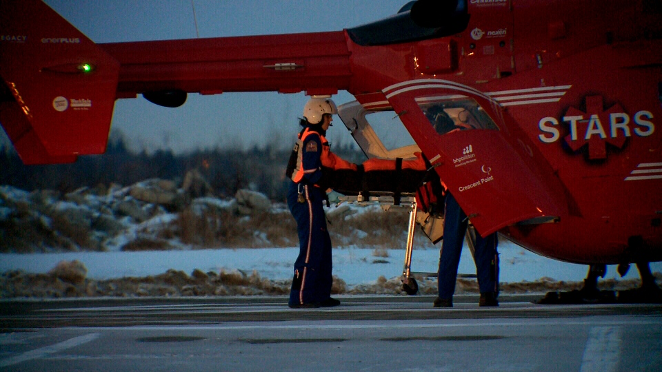A person injured in a shooting in La Loche, Sask. is unloaded from a STARS air ambulance in Saskatoon on Friday.