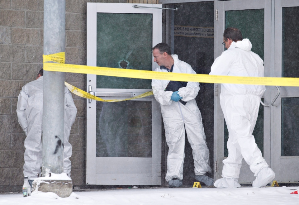 Police investigate the scene Saturday, Jan. 23, 2016 of a Friday shooting at a school in La Loche, Sask. THE CANADIAN PRESS/Jason Franson