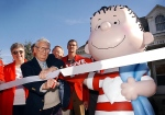 In a Sept. 23, 2003 file photo, the real Linus, artist Linus Maurer, cuts a ribbon after unveiling a statue of Linus of 'Peanuts' comic strip fame during a ceremony at his hometown of Sleepy Eye, Minn. (John Cross/The Free Press via AP)