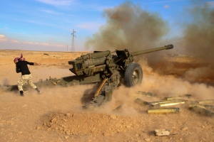 In this photo taken on Saturday, Jan. 30, 2016, Syrian government troops fire at Islamic State group positions near Mahin, Syria. (Alexander Kots/Komsomolskaya Pravda via AP)