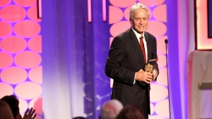 Michael Douglas accepts the Career Achievement Award at the 15th Annual Movies for Grownups Awards at the Beverly Wilshire Hotel in Beverly Hills, Calif. on Monday, Feb. 8, 2016. (Rich Fury / Invision)