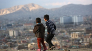 Afghan boys look at the view of Kabul city, in Kabul, Afghanistan, Sunday, March 6, 2016. (AP / Rahmat Gul)