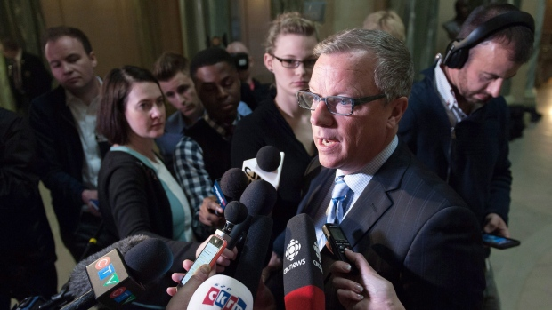 Brad Wall speaks to media one day after the Saskatchewan Party's electoral victory at the Legislative Building in Regina on Tuesday April 5, 2016. THE CANADIAN PRESS/Michael Bell