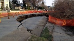 A collapsed chunk of road on Saskatchewan Crescent East, between 16th Street and 17th Street, is seen here on Monday, April 25, 2016. (Colin Thomas/CTV Saskatoon)
