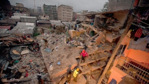 Rescuers work at the site of a building collapse in Nairobi, Kenya, Saturday, April 30, 2016. (AP /Sayyid Abdul Azim)