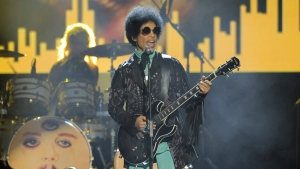 Prince performs at the Billboard Music Awards at the MGM Grand Garden Arena in Las Vegas on May 19, 2013. (Chris Pizzello / Invision)