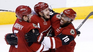 In this file photo, Arizona Coyotes' Oliver Ekman-Larsson, middle, of Sweden, celebrates his goal against the Washington Capitals with Anthony Duclair (10) and Connor Murphy, left, during the third period of an NHL hockey game Saturday, April 2, 2016, in Glendale, Ariz. The Coyotes defeated the Capitals 3-0. (AP Photo / Ross D. Franklin)