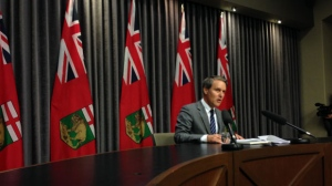 Manitoba Finance Minister Cameron Friesen is forecasting a deficit of $911 million, down $100 million from last year.