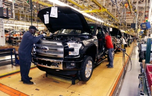 In this Nov. 6, 2014 photo, the new Ford F-150 truck is assembled at the Rouge Truck Plant in Dearborn, Mich. (AP Photo/Carlos Osorio)
