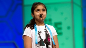 Vanya Virmani, 8, of Fredericton, New Brunswick, spells her word during the preliminary round two of the Scripps National Spelling Bee in National Harbor, Md., Wednesday, May 25, 2016. (AP Photo/Cliff Owen)