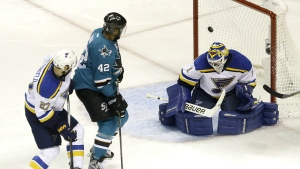 San Jose Sharks right wing Joel Ward scores a goal between St. Louis Blues defenceman Alex Pietrangelo and goalie Brian Elliott during the second period in Game 6 of the NHL hockey Stanley Cup Western Conference finals in San Jose, Calif. on Wednesday, May 25, 2016. (AP / Jeff Chiu)