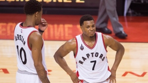 Toronto Raptors guard Kyle Lowry (7) looks on with teammate DeMar DeRozan (10) while playing against the Cleveland Cavaliers during second half Eastern Conference final NBA playoff basketball action in Toronto on Friday, May 27, 2016. (Nathan Denette / THE CANADIAN PRESS)