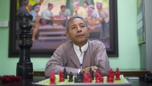Thein Zaw, Myanmar Chess teacher and former champion posing at the Myanmar Chess Federation in Yangon. (AFP PHOTO/YE AUNG THU)