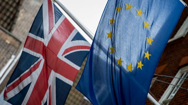 Flags fly outside Europe House, the European Parliament's British offices, in central London, with European flag, right, and Britain's Union flag, Tuesday June 21, 2016. (Lauren Hurley / PA via AP)