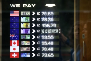 Foreign exchange rates for notes of various currencies are displayed in the window of a Bureau de Change in Westminster following yesterday's EU referendum result, London, Saturday, June 25, 2016. (AP / Tim Ireland)