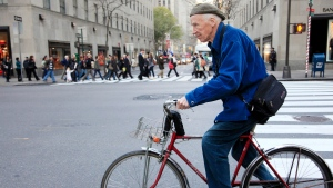 This Nov. 23, 2010 photo shows New York Times photographer Bill Cunningham bicycling to work in New York. Cunningham, a longtime fashion photographer for The New York Times known for taking pictures of everyday people on the streets in New York died on Saturday, June 25, 2016, after suffering a stroke in New York. He was 87. (AP / Mark Lennihan)