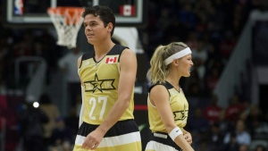Canadian tennis players Milos Raonic and Eugenie Bouchard take to the court during the NBA celebrity all-star game in Toronto, on Friday, Feb. 12, 2016. (THE CANADIAN PRESS/Chris Young)