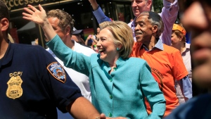Democratic presidential candidate Hillary Clinton, center, marches in the New York City Pride Parade with New York Gov. Andrew Cuomo, left, Mayor Bill de Blasio, back right, and the Rev. Al Sharpton in New York, Sunday, June 26, 2016. (AP Photo / Seth Wenig)