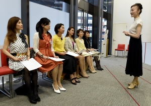 "This photo taken on April 7, 2016 shows the Japan High Heel Association managing director ""Madame"" Yumiko giving a lesson on high heels in Tokyo. 